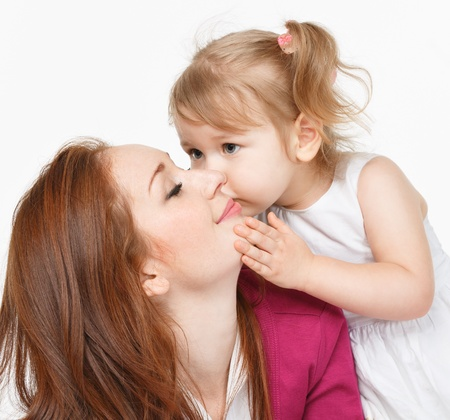 mother day: Happy woman and young girl (child)smiling in bed. Mother day concept Stock Photo