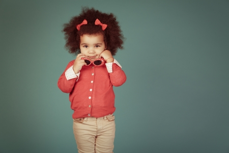 famale: Vintage happy african girl against green background. Stock Photo