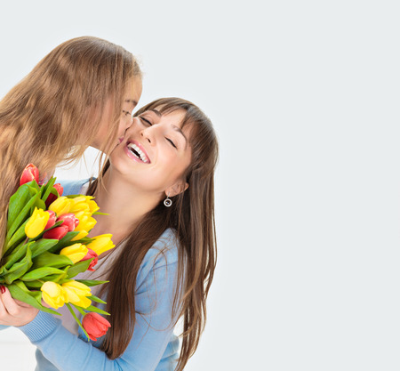 Picture of mother and daughter with flowers. Mother day concept