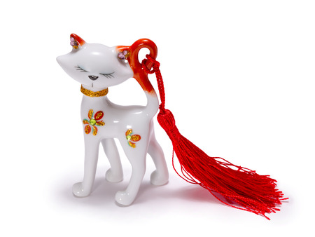 Beautiful figurine of a white cat - isolated on white background Stock Photo