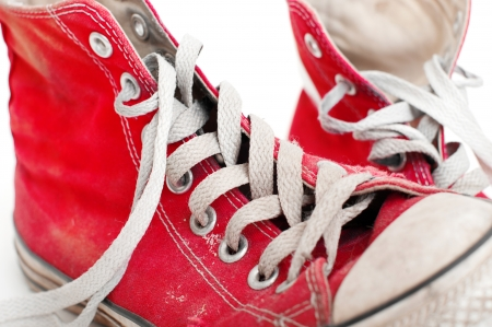 old red shoes on a white background photo