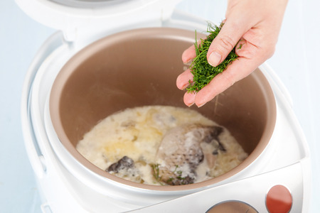 slow cooker: add dill in sauce for baked carp closeup