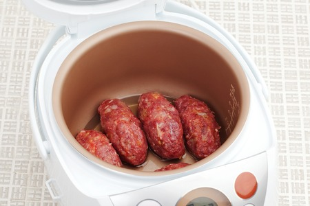 The process of cooking meatballs in Multicooker closeup
