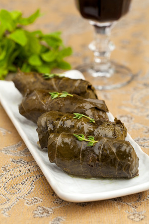meat dish: stuffed cabbage rolls in grape leaves on a decorated table closeup Stock Photo