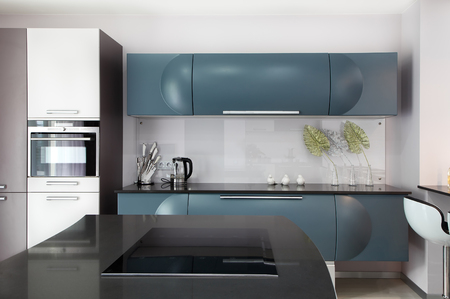The spacious modern kitchen in the apartment. Modern kitchen design solution