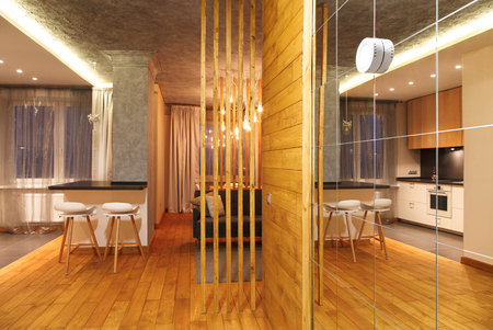 kitchen decoration: Minimalist interior studio apartments with concrete walls and parquet floors