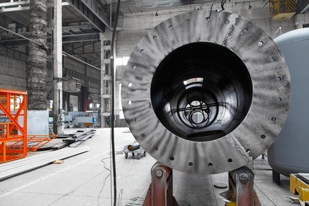 round rods: Process of assembly in the modern pipeline complex old factory. Steel pipe production plant Stock Photo