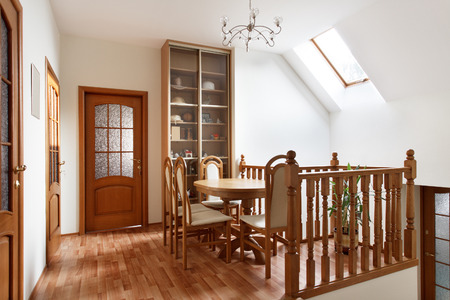 Small dining room with wooden table and chairs upstairs