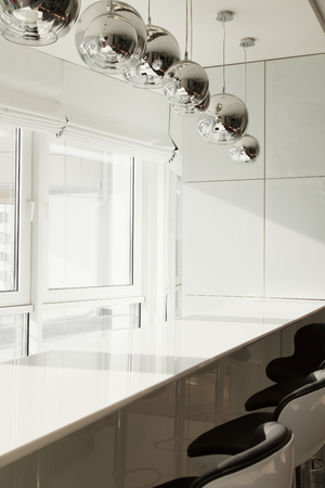 Breakfast bar in a modern apartment in a large window. The kitchen in bright colors