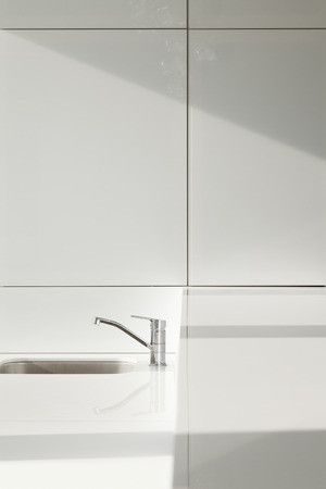Sink and faucet in the kitchen made in minimalist style Stock Photo