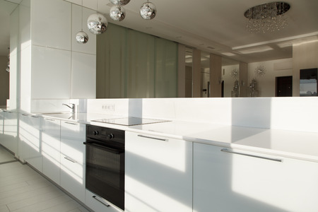 Interior studio apartments design in minimalist style and white colors. High tech