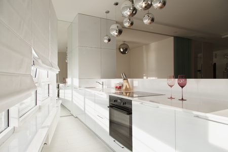 Modern interior studio apartments design in minimalist style and white colors. Interior design in the style of high-tech