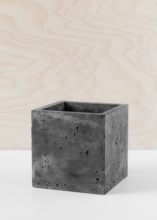 Stylish black pot of fibrous concrete for indoor plants