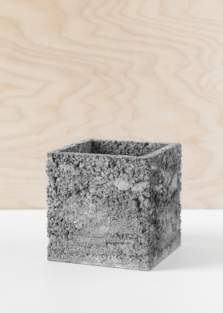 Brutal grey pot of concrete for indoor houseplants Stock Photo