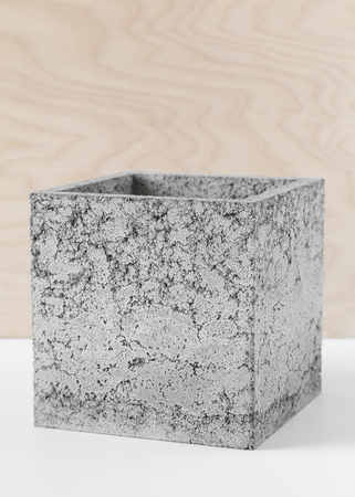 Brutal grey pot of fibrous concrete for indoor plants Stock Photo