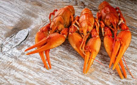 Boiled crayfish on wood background. Close Up