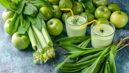 Food banner detox smoothie. Green apples, celery, ramson and limes on a concrete background. Detox program, diet plan, weight loss.