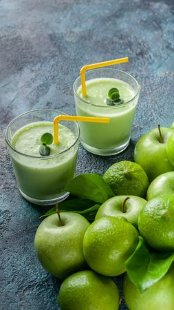 Vertical food banner smoothies apples and limes on a dark blue concrete background. Detox programm Stock Photo