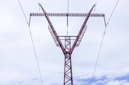 High voltage power pole. Metal tower on a sky background