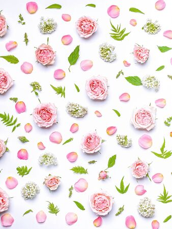 Vertical flower pattern: roses, hawthorn flowers, rowan leaves on a white background. Top view