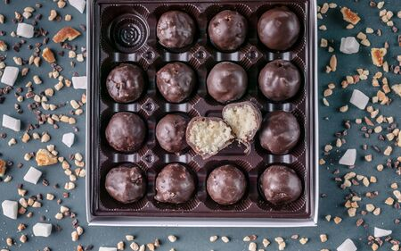 Handmade chocolates with coconut and honey. Gourmet Chocolate in a Gift Box. Top view