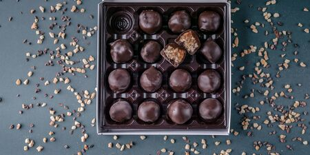 Food banner: Handmade chocolates with honey and nuts. Gourmet Chocolate in a Gift Box. Top view Stock fotó
