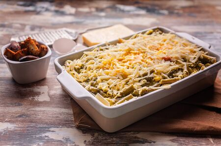Vegetable lasagna with green beans and cheese in a ceramic bowl. Healthy vegetarian food.