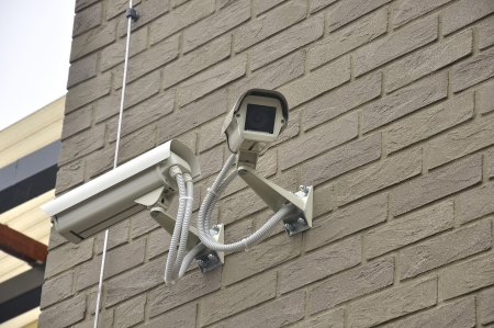 Security surveillance video cameras on the wall photo