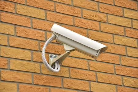 Security surveillance video camera on the wall photo