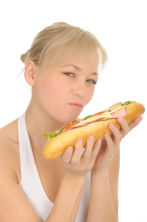 Woman with sandwich, isolated on white. photo