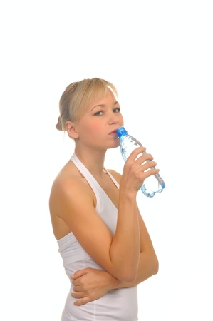 beautiful woman with bottle of water over white. photo