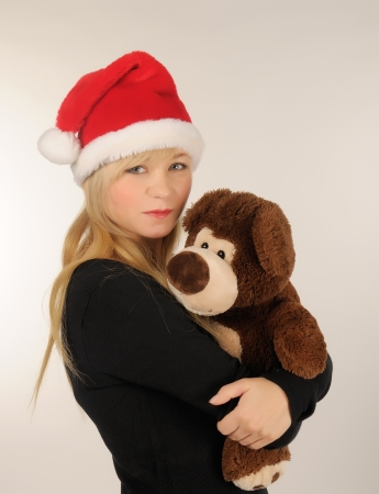 Santa woman with bear. photo