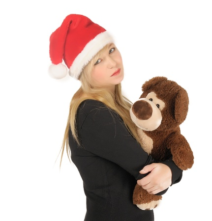 Santa woman with bear isolated on white. photo