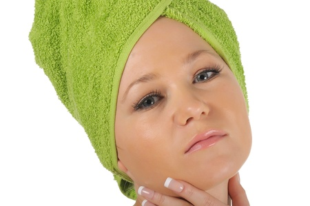 Spa Girl. Beautiful Young Woman After Bath with green towel. isolated on white. photo
