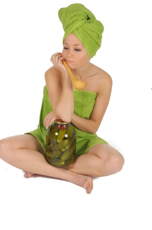 saun: Spa Girl. Beautiful Young Woman After saun with jar of a cucumbers and wood spoon. isolated on white. Stock Photo