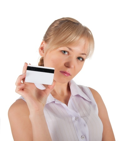A woman holds in her hand a plastic card for purchases. on a white background. photo