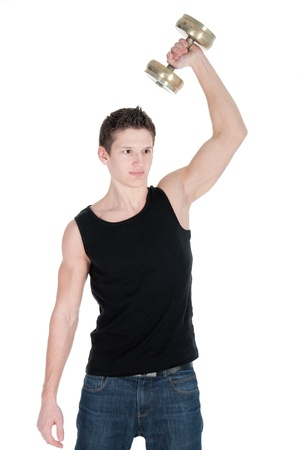 Portrait of a healthy young man doing exercise with dumbbell against white background. photo