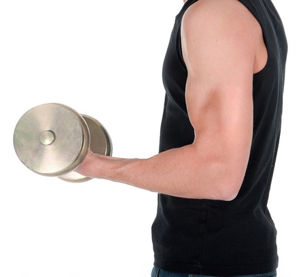 healthy young man doing exercise with dumbbell against white background. photo