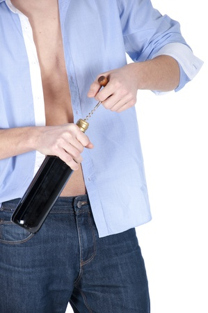 broaching: A man opens a bottle of his favorite wine.