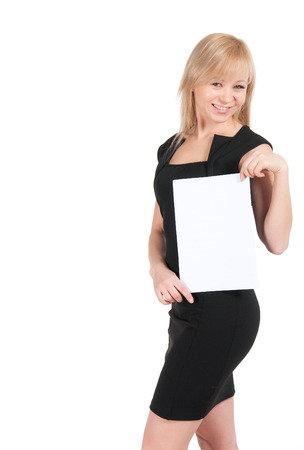 Young attractive business woman with a blank sheet of paper isolated on white. photo