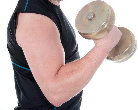 healthy young man doing exercise with dumbbell against white background Stock Photo - 23812747