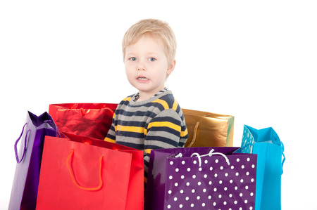 attractive boy with shopping bags  isolated on white background. photo