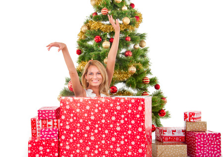 woman inside of gift box and christmas tree behind photo