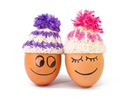 warmer: funnylovely eggs in winter hats. together is more warmer .