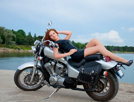 Beautiful, sexy, young woman on a motorcycle. 版權商用圖片