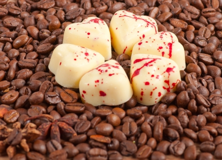 coffee beans and white chocolate heart candy. photo