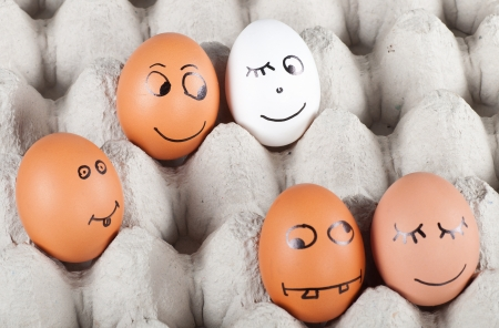 group of  funny smiling eggs in a packet.