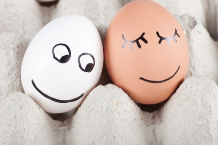 two funny smiling eggs in a packet. photo