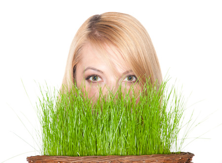 woman holding easter basket with green grass. symbol of nature photo