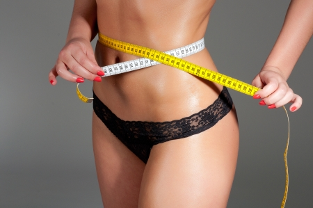 woman measuring perfect shape of beautiful thigh healthy lifestyles concept. Stock Photo